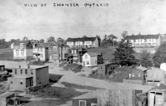 View from a postcard taken near the corner of Durie and Morningside, shows the houses on lower Beresford Ave and Runnymede not yet developed and the back of Rennie's Row on Kennedy. Swansea Historical Society archives.