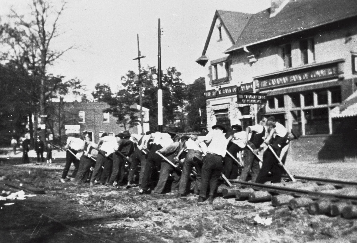 Laying tracks in 1917 at Runnymede and Bloor, in front of CIBC (now replaced by McDonalds) - photo via Toronto Archives