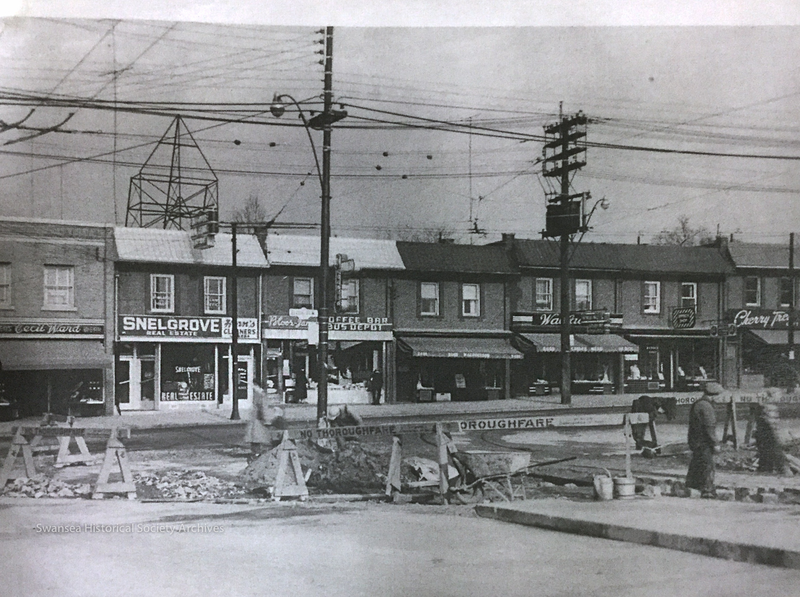 Looking north from the TTC Jane loop at Jane and Bloor sometime in the early 1950s. Cecil Ward and Sons menswear (left) opened in Bloor West Village in 1939 at 2438 Bloor Street West (TD Bank, today). They moved to 2416 Bloor Street West in 1993, where they remain to this day as one of the oldest retail stores in the area. Source unknown.