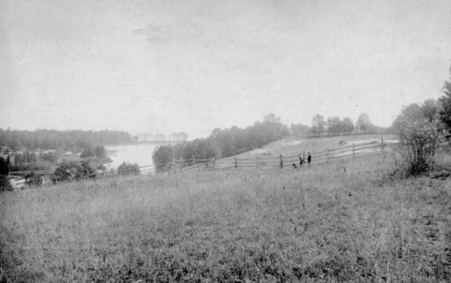 Swansea, 1900. This view looks south from Morningside, east of Ellis Avenue, with Grenadier Pond on the left. The sand bar between the Pond and Lake Ontario can be seen at the south end of the Pond.