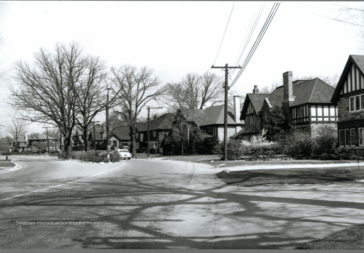 Riverside Drive - This 1953 photograph, looking north, shows the island which still exists just south of Riverside Crescent and some of the homes developed as part of the Riverside Subdivision by Robert Home Smith in the 1930s.