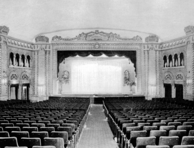 """Canada's Theatre Beautiful,"" the Runnymede Theatre, as it appeared inside when opened in 1927. It was built in an 'atmospheric' style to simulate open air, with a curved azure blue ceiling surrounded by a simulated garden wall."