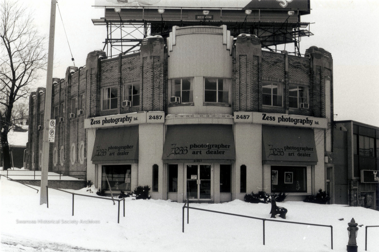 The Kingsway Pharmacy was officially opened Nov. 12 1936. It housed a dispensary, perfume and cosmetic bar, candy and chocolate counter, tobacco counter, soda luncheonette, beauty salon, and dental and medical suites which catered to the many needs of the community. It is now a dog daycare (2017). Via Swansea Historical Society