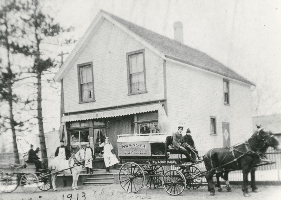 Howard's grocery store, 33 Lavinia Ave, 1913. A very popular stop for children coming and going to school. Earl Rabjohn (driving white horse) ; unidentified figure seated beside him; Walter Edge; Fred Edwards; Mr Hall; unidentified man on cart; Roy Rabjohn (on cart). Photo via Toronto Public Library